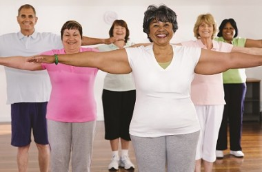 Multi-ethnic adults taking exercise class
