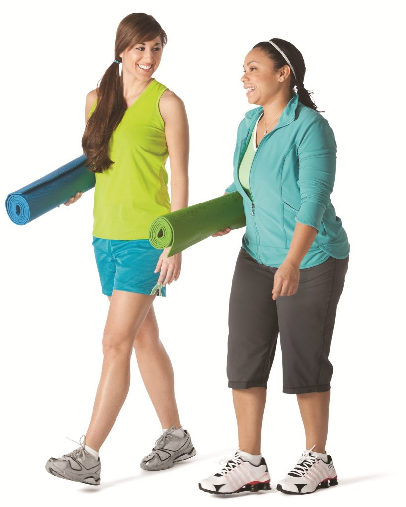 Two women with yoga mats